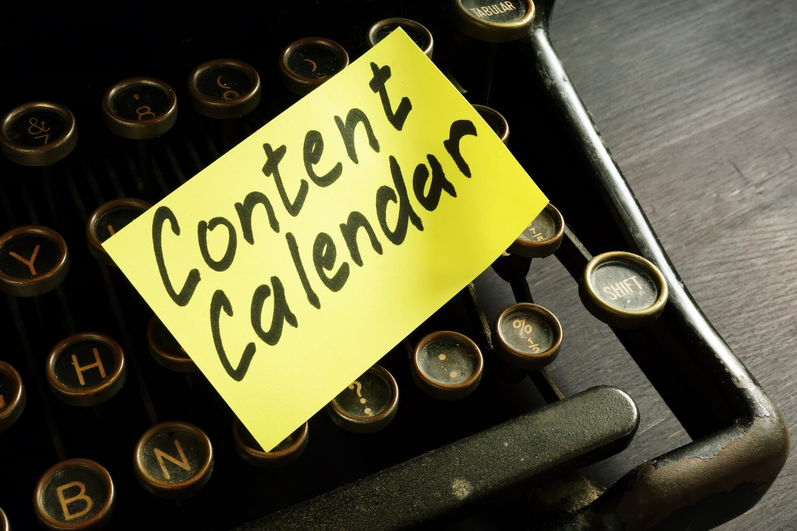 retro typewriter with content calendar memo